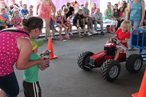 Kid-on-pedal-tractor